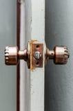 Door knob. Bronze round door knob on a gray door Stock Images