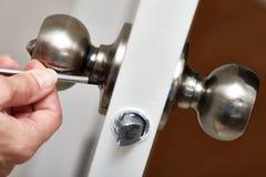Door knob installation. Stock Image