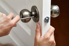 Door knob installation. Stock Images