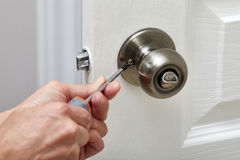 Door knob installation. Stock Photos