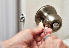 Door knob installation. Royalty Free Stock Photography