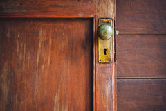 Door knob and keyhole made of brass Stock Images