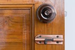 Door knob and keyhole on wooden door Stock Photography