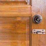 Door knob and keyhole on wooden door Royalty Free Stock Image