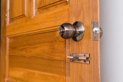 Door knob and keyhole on wooden door Royalty Free Stock Photography