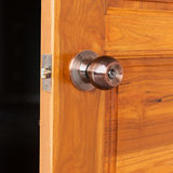 Door knob and keyhole on wooden door Royalty Free Stock Images
