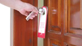 Door knob. The man inserts the key, opens the door and enters the room. side view. Door knob. The man inserts the key, opens the door and enters the room. side stock video
