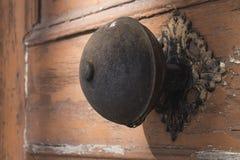 Door knob. Old Latvian church wooden door with metal knob Stock Photo