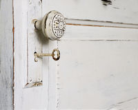 Door Knob and Skeleton Key. An Old Fashioned Door with a knob and Skeleton Key royalty free stock photos