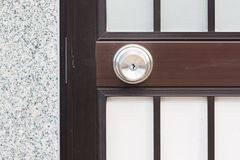 Door Knob stainless on modern door. Royalty Free Stock Photo