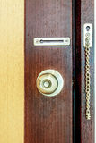 Door knob on wood door background Royalty Free Stock Photography