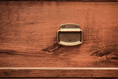 Door knob Wooden chest of drawers Stock Photos