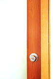 Door knob on wooden door Stock Images