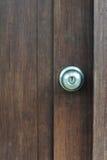 Door knob on wooden door Royalty Free Stock Photo