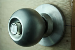 Door knob on unpainted Wooden Door Royalty Free Stock Photo