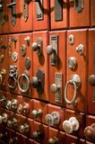 Door knobs. A display of metal antique door knobs and knockers Royalty Free Stock Photography