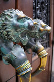 Door Knobs. Ornate door handles with lion faces Royalty Free Stock Photos