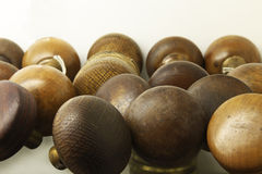 Door knobs. Brass and wood door knobs in a collection on a shelf close-up Royalty Free Stock Images