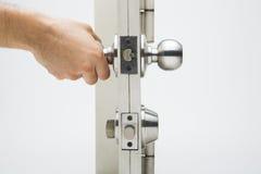 The Door knobs, aluminum door white background. Door knobs, aluminum door white background Stock Photo