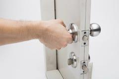 The Door knobs, aluminum door white background. Door knobs, aluminum door white background Stock Photos