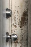 Door knobs door lock. On the old paint background Stock Images