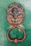 Door knock. Ancient door knock on green old door royalty free stock photography