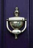 Door Knocker. Brass door knocker on a purple door Royalty Free Stock Photography