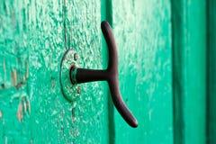 Door Knocker. Spanish decorative old knocker on green door royalty free stock image