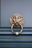 Door knocker. Typical Parisian door knocker in brass stock photos