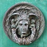 Door knocker. A closeup of an old bronze door knocker at the Brighton Pavilion Stock Photos