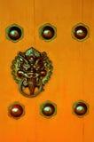 Door Knocker. Oriental door knocker with textures on the door Stock Image