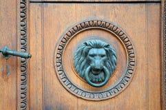 Door knocker. A Lion door knocker on an old wooden door in Vienna Stock Photos