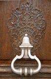 Door knocker. Vintage door knocker on the wooden door Royalty Free Stock Photo