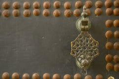 Door knocker. Detail of old wooden door in Tangier, Morocco Royalty Free Stock Image