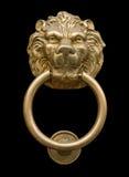 Door knocker. Lion's head door knocker isolated on black stock photo