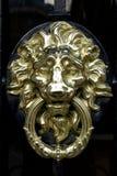 Door knocker. Typical Parisian door knocker in brass stock image