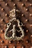 Door knocker on antique portal Stock Image