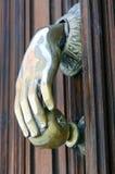 Door Knocker. Avila. A solid brass door knocker shaped as a hand holding an apple. Taken in Avila, Spain Royalty Free Stock Images