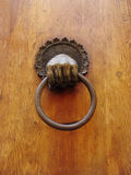 Door knocker. Close up on antique door knocker Stock Image