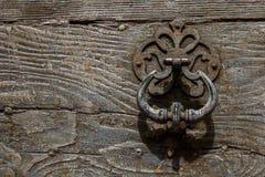 Door knocker. Elegant door knocker on wood door in arles, france stock photography