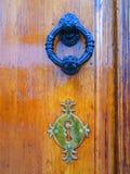 Door knocker and fake keyhole Stock Photo