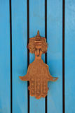 Door knocker - hamsa. Brass door knocker shaped as hamsa ( Hand of Fatima Stock Photography
