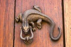 Door knocker Iguana shaped. At Cartagena de Indias Stock Images