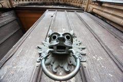 Door knocker with lion head. Door handle and door knocker with lion head royalty free stock photo