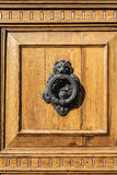 Door knocker with lion head. In a classic building in the old town of Barcelona; Catalonia, Spain royalty free stock photography