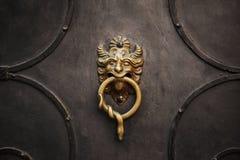 Door knocker. With lion on iron door royalty free stock images