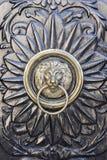 Door knocker with lion's head. Beautiful decorated door knocker with lion's head royalty free stock image