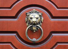 Door Knocker. Lion-shaped metal door knocker Stock Images