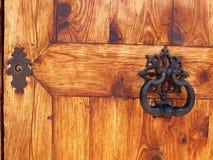 Door knocker and locker. Wooden gate doors with ancient iron knocker and locker Stock Image