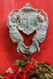 Door knocker of a maltese house. Vintage brass metal door knocker in Malta Royalty Free Stock Photo